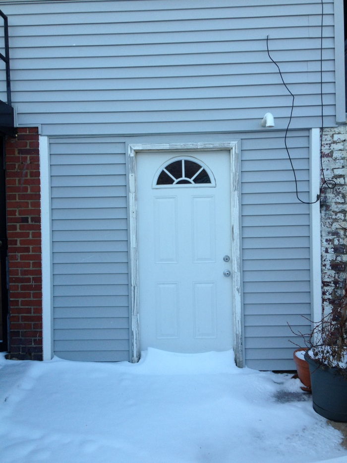 The newly sided back door
