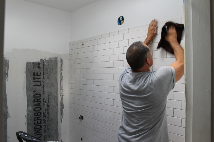 Dad cleaning tiles