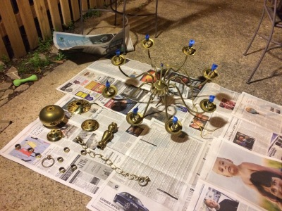 Disassembled tacky brass chandelier